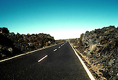 Asphalt road through  lava field in Hawaii