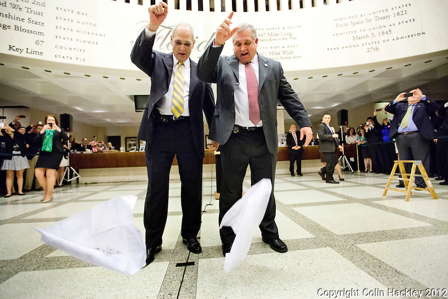 TALLAHASSEE, FLA.3/9/12-SESSIONEND030912 CH-House Sergeant at Arms Earnest Sumner, left and Senate Sergeant at Arms Donald Severance drop their handkerchiefs to signal the close of the 2012 legislative session, Friday at the Capitol in Tallahassee...COLIN HACKLEY PHOTO