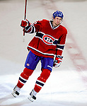 26 October 2009: Montreal Canadiens' left wing forward Travis Moen salutes the crowd after being named the first star of the game against the New York Islanders at the Bell Centre in Montreal, Quebec, Canada. The Canadiens defeated the Islanders 3-2 in sudden death overtime for their 4th consecutive win. Mandatory Credit: Ed Wolfstein Photo