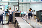 Airport security check and hand luggage scan in Canada