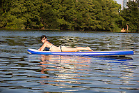 Stand up paddle surfing (SUP) sport benefits athletes with a strong 'core' workout. SUP'ing is popular at warm coastal climates and resorts, and is gaining in popularity as celebrities are sampling the sport, and cross-over athletes are training with SUP. Austin, Texas.