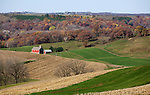 A collection of Barns that still can be seen while traveling the countryside in  the beautiful State of Wisconsin.<br /> Iowa County- Farm and valley from County Road A, east of Hollandale.