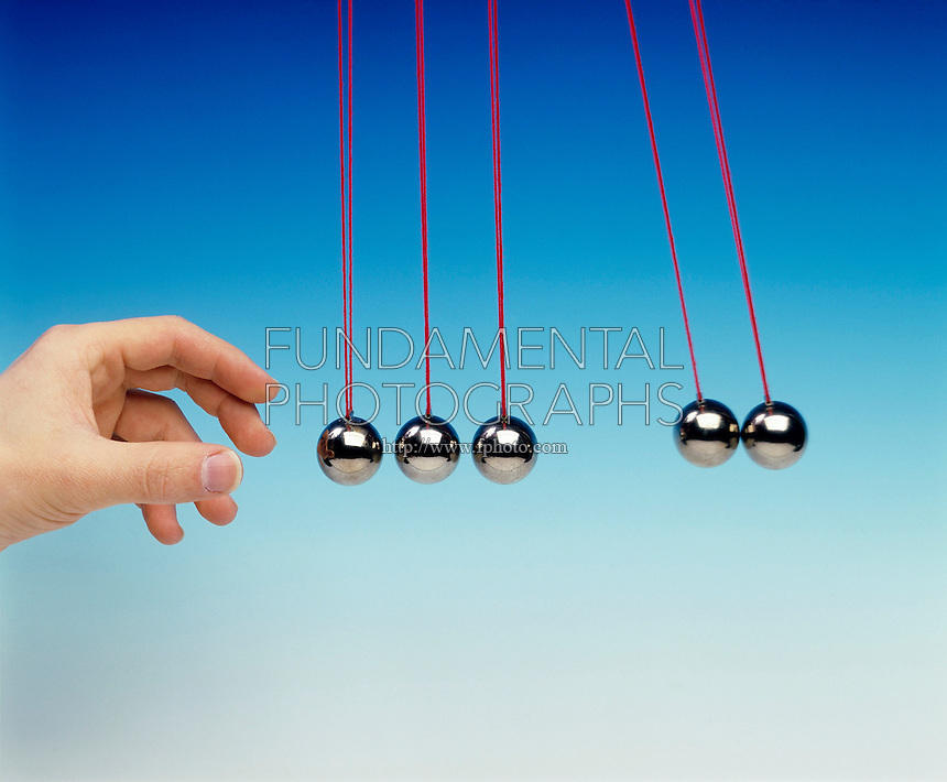 NEWTON TOY PENDULA: COLLISION EXPERIMENT<br /> Newton's Third Law <br /> (8 of 8 - Variations Available)<br /> Conservation of Momentum<br /> Two pendula bobs used as a projectile collides with three other pendula bobs displacing two pendula bobs equal to the original displacement of the projectile bob.