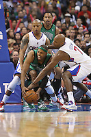 12/27/12 Los Angeles, CA: Boston Celtics small forward Paul Pierce #34,Los Angeles Clippers small forward Caron Butler #5 and  power forward Lamar Odom #7 during an NBA game between the Los Angeles Clippers and the Boston Celtics played at Staples Center. The Clippers defeated the Celtics 106-77 for their 15th straight win.