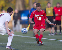Rutgers University defender Paulie Calafiore (16) passes the ball.  Rutgers University defeated Boston College in penalty kicks after two overtime periods in NCAA Division I tournament action, at Newton Campus Field, November 20, 2011.