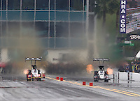 Mar 14, 2015; Gainesville, FL, USA; NHRA top fuel dragster driver Larry Dixon (right) races alongside Doug Kalitta prior to crashing after his car broke in half during qualifying for the Gatornationals at Auto Plus Raceway at Gainesville. Dixon walked away from the incident. Mandatory Credit: Mark J. Rebilas-