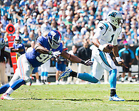 The Carolina Panthers played the New York Giants at Bank of America Stadium in Charlotte, NC.  The Panthers won 38-0 for their first victory of the season.  The Giants dropped to 0-3.  Carolina Panthers quarterback Cam Newton (1), New York Giants defensive end Justin Tuck (91)