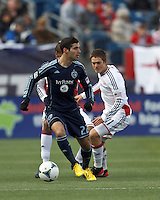 Sporting Kansas City midfielder Soony Saad (22) looks to pass.  In a Major League Soccer (MLS) match, Sporting Kansas City (blue) tied the New England Revolution (white), 0-0, at Gillette Stadium on March 23, 2013.