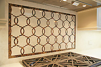 Seine, a custom half scale natural stone waterjet mosaic backsplash shown in Emperador Dark and Botticino, is part of the Silk Road Collection by Sara Baldwin for New Ravenna Mosaics. Take the next step: prices, samples and design help, http://www.newravenna.com/showrooms/
