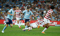 Sydney FC Terry Antonis (17) is fouled by Wanderers Michael Deuchamp during their A-League match in Sydney, March 8, 2014. VIEWPRESS/Daniel Munoz EDITORIAL USE ONLY