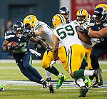 Seattle Seahawks running back Robert Turbin (22) rushes  against the Green Bay Packers in the NFL Kickoff held at CenturyLink Field in September 4, 2014 in Seattle.  Seattle beat Green Bay 36-16. ©2014   Seattle beat Green Bay 36-16. ©2014  Jim Bryant Photo. ALL RIGHTS RESERVED.