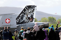 Swiss F-18 Hornet with tiger paint scheme. Specially painted aircraft is often of particular interest for plane spotters. Tiger Air show.  Nato Tiger Meet is an annual gathering of squadrons using the tiger as their mascot. While originally mostly a social event it is now a full military exercise. Tiger Meet 2012 was held at the Norwegian air base &Oslash;rlandet.