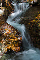 A fresh mountain creek  finding its way through boulders and rocks at the Angeles National Forest in Southern California.