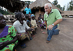 Father Mario Benedetti (right), a Comboni father from Italy, talks with other residents of the Makpandu refugee camp in Southern Sudan, 44 km north of Yambio, where more that 4,000 people took refuge in late 2008 when the Lord's Resistance Army attacked their communities inside the Democratic Republic of the Congo. Attacks by the LRA inside Southern Sudan and in the neighboring DRC and Central African Republic have displaced tens of thousands of people, and many worry the attacks will increase as the government in Khartoum uses the LRA to destabilize Southern Sudan, where people are scheduled to vote on independence in January 2011. Father Benedetti and other Catholic pastoral workers have accompanied the people of this camp from the beginning, with Father Benedetti living in the middle of the camp. NOTE: In July 2011 Southern Sudan became the independent country of South Sudan.
