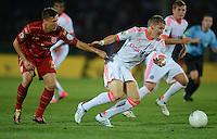 FUSSBALL  DFB POKAL       SAISON 2012/2013 Jahn Regensburg - FC Bayern Muenchen  20.08.2012 Markus Smarzoch (li, SSV Jahn Regensburg) gegen Bastian Schweinsteiger (FC Bayern Muenchen)