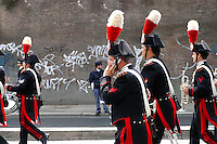 Rome  June 2  2006..Republic Day. Italian Carabinieri march during the military parade .A carabiniere talks to the cellular phone during the parade