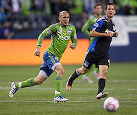 Osvaldo Alonso, left, of the Seattle Sounders FC and Sam Cronin of the San Jose Earthquakes chase down a ball during play at CenturyLink Field in Seattle Saturday October 15, 2011. The Sounders FC won the game 2-1.