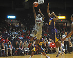 "Ole Miss guard Chris Warren (12)  shoots as Louisiana State's Ralston Turner (22) defends at the C.M. ""Tad"" Smith Coliseum in Oxford, Miss. on Wednesday, February 9, 2011. Ole Miss won 66-60 and is now 4-5 in the Southeastern Conference."