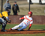 Lafayette High's Mason Phillips (8) scores vs. Olive Branch in Oxford, Miss. on Wednesday, March 13, 2013.