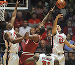 "Mississippi's Marshall Henderson (22) blocks the shot of Arkansas'  Marshawn Powell (33) and Mississippi's Reginald Buckner (23) also defends at the C.M. ""Tad"" Smith Coliseum in Oxford, Miss. on Saturday, January 19, 2013. (AP Photo/Oxford Eagle, Bruce Newman)"