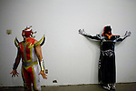 Lucha Libre AAA wrestlers Laredo Kid, left, La Parka, right, wait backstage in Sacramento, CA March 28, 2009.