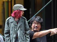 NEW YORK, NY-July 23:  Joon-ho Bong, Lily Collins shooting on location for Netflix & Plan B Enterainment  film Okja in New York. NY July 23, 2016. Credit:RW/MediaPunch