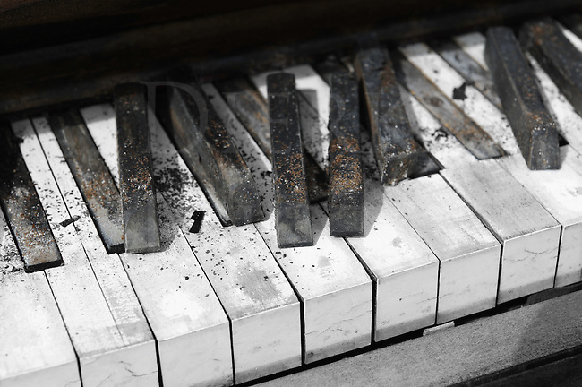 I found this homeless piano sitting outside in a remote corner of a small country truck stop, down at the end of a row of parked trucks. It was very deteriorated and half broken up from being out through all seasons for decades in ice, rain, and snow; through Arizona heat and Montana cold. It was the centerpiece sitting in a small junk pile of assorted debris and common trash. My guess was that it was put there on a midnight dump-and-run mission just to get rid of it, and not for music at any yee-haw trucker's parties.<br />