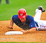 8 March 2009: Washington Nationals' third baseman Ryan Zimmerman dives safely back to first during a Spring Training game against the New York Mets at Space Coast Stadium in Viera, Florida. The Nationals defeated the Mets 8-3 in the Grapefruit League matchup. Mandatory Photo Credit: Ed Wolfstein Photo