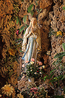 Shrine in a grotto to Our Lady of Lourdes, originally created 1885 by Fulgenzio Malagoli and rebuilt by Croatian sculptor Lojzika Ulman, inside St Ignatius Church, Old Town, Dubrovnik, Croatia. The city developed as an important port in the 15th and 16th centuries and has had a multicultural history, allied to the Romans, Ostrogoths, Byzantines, Ancona, Hungary and the Ottomans. In 1979 the city was listed as a UNESCO World Heritage Site. Picture by Manuel Cohen