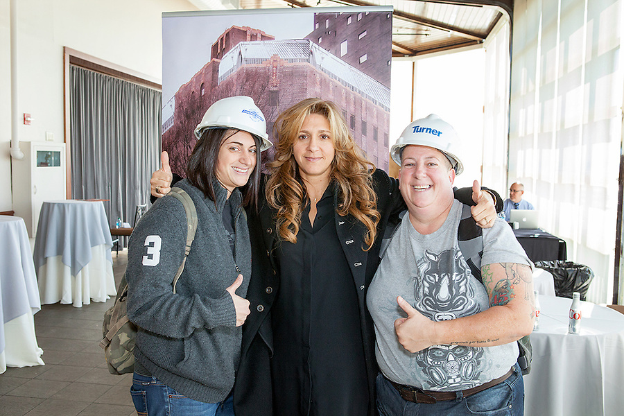Lela Goren(center) is the Founder of Goren Group, a woman-owned real estate development and investment company, poses with construction workers in hard hats at the NoVo Foundation's Women's Building announcement in NYC, October 26, 2015