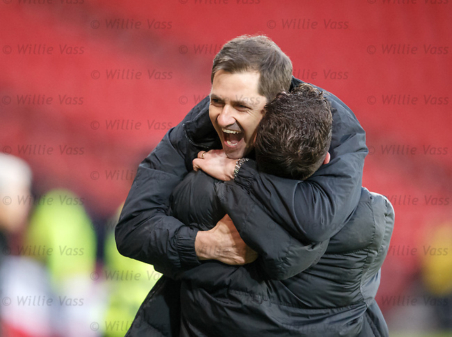 Jackie McNamara hugs coach Darren Jackson as the final whistle puts Dundee Utd through to the final