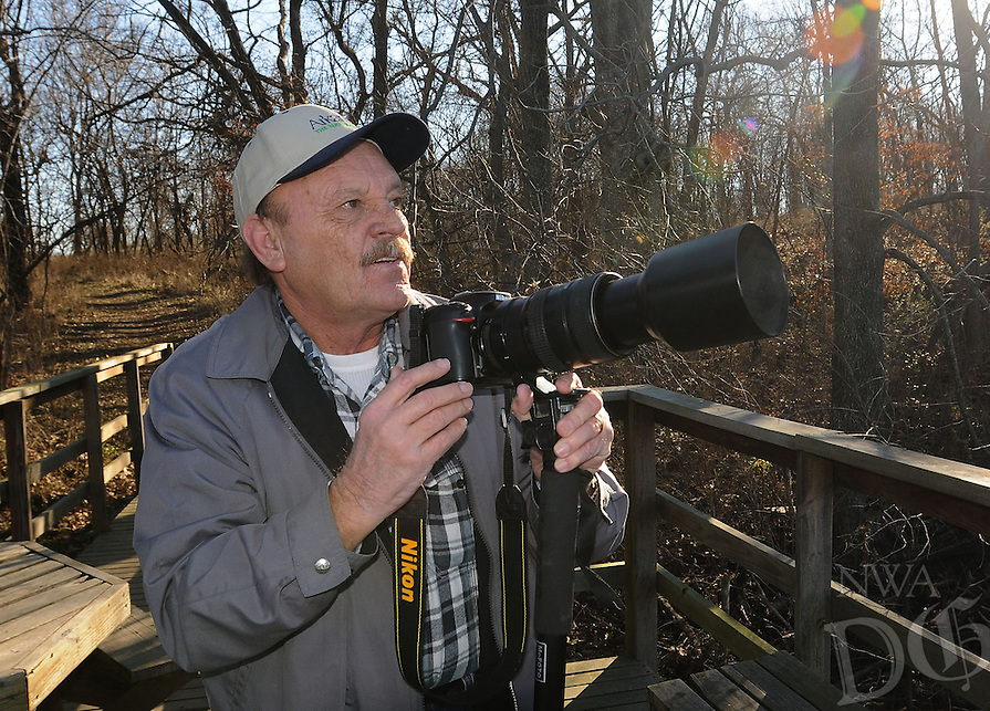 NWA Democrat-Gazette/FLIP PUTTHOFF<br /> Terry Stanfill photographs bald eagles Jan. 14, 2016 at Swepco Lake along the Eagle Watch Nature Trail near Gentry. Stanfill, of the Decatur area, is  caretaker of the trail located near the Flint Creek Power Plant. Many of his nature photos are taken on the trail.
