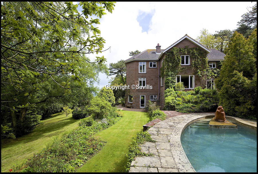 BNPS.co.uk (01202 558833)<br /> Pic: Savills/BNPS<br /> <br /> The outdoor swimming pool.<br /> <br /> Whicker's real world...<br /> <br /> The beloved island retreat of legendary globe-trotting journalist Alan Whicker has gone back on the market two years after his death - with &pound;1 million knocked off the asking price.<br /> <br /> The plush four-bedroom home on the Channel Island of Jersey was first put up for sale after he died in 2013 aged 91 for just under &pound;5 million.<br /> <br /> But despite being nestled in nine acres of secluded woodland and boasting an outdoor swimming pool with sweeping views towards France, the house failed to sell.<br /> <br /> Whicker's longterm partner Valerie Kleeman, who lived at the property with him for more than 40 years, took it off the market but has now put it up for sale again for &pound;3.95 million in the hope of enticing buyers.