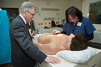 Dean Rick Morin, M.D., left, Vivian Jordan. Simulation center open house.