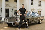 Uri Geller at home Berkshire England 2008. Uri with his custom built 1976 Cadillac  encrusted with over 5,000 pieces of contorted and bend spoons and cutlery.