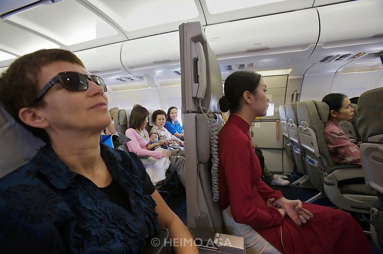 Nicole schmidt l next to a flight attendant aboard a vietnam