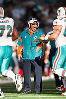 ARLINGTON, TX - NOVEMBER 24:   Head Coach Tony Sparano of the Miami Dolphins congratulates his team coming off the field during a game against the Dallas Cowboys at Cowboys Stadium on November 24, 2011 in Arlington, Texas.  The Cowboys defeated the Dolphins  20 to 19.  (Photo by Wesley Hitt/Getty Images) *** Local Caption *** Tony Sparano