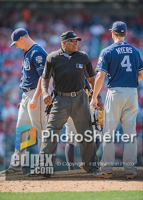 24 July 2016: MLB Umpire Laz Diaz makes a visit to the mound as he works home plate during a game between the San Diego Padres and the Washington Nationals at Nationals Park in Washington, DC. The Padres defeated the Nationals 10-6 to take the rubber match of their 3-game, weekend series. Mandatory Credit: Ed Wolfstein Photo *** RAW (NEF) Image File Available ***