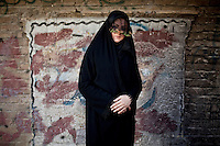 A woman during the 'Chehel Manbar' (Fourty Pulpit) ceremony held the day before Ashura in Khorramabad. Traditionally, Iranian women walk bare-footed to light 40 candles in designated places in the centre of the city starting early in the morning.