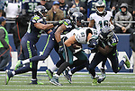 Philadelphia Eagles tight end Brent Celek (87) is wrapped up by Seattle Seahawks strong safety Kam Chancellor (31) cornerback Richard Sherman (25) at CenturyLink Field in Seattle, Washington on November 20, 2016.  Seahawks beat the Eagles 26-15.  ©2016. Jim Bryant Photo. All Rights Reserved.