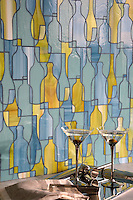 Bottles, a waterjet glass mosaic shown in Peridot, Serpentine, and Mica, is part of the Erin Adams Collection for New Ravenna Mosaics.<br />