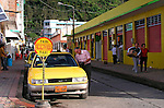 Taxi wait for fares in Banos, Ecuador.