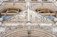 Th pediment above the entrance to 281 Park Avenue South in New York on Tuesday, July 19, 2016. Formerly the Church Missions House and then the home of the Federation of Protestant Welfare Agencies (FPWA) the building was designated a landmark in 1979. Designed by Robert W. Gibson and Edward J. N. Stent it was built between 1892 and 1894. It is currently owned by RFR Realty which is marketing it a single company office building. (© Richard B. Levine)