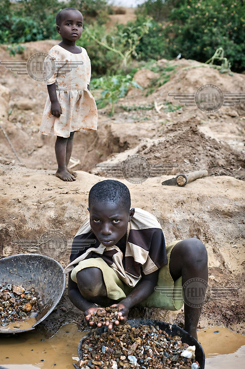 Children working in the gold mines of northern Tanzania wash stones, searching for traces of gold.