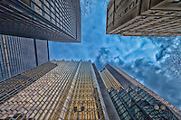Looking up to the sky between the towers in Toronto's financial district.