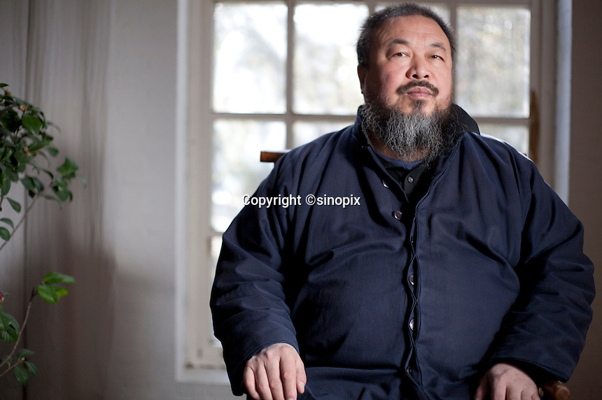 Ai Weiwei photographed in his Beijing studio after the forced demolition of his Shanghai studio by the Chinese government, Beijing, China. Ai Weiwei is a Chinese artist and activist. He intensively uses the internet to communicate with people all over China. On 3 April 2011, police detained him at Beijing airport, his studio in the capital was sealed off, and his staff interrogated pursuant to offical allegations of 'economic crimes'.<br />