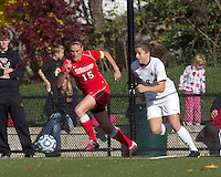 Marist College defender Chelsea Botta (15) starts bringing the ball out as Boston College forward Stephanie McCaffrey (9) closes. Boston College defeated Marist College, 6-1, in NCAA tournament play at Newton Campus Field, November 13, 2011.