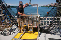 A crew member explains the underwater camera equipment aboard the Environmental Protection Agency OSV Bold in New York at Riverbank State Park on Saturday, July 31, 2010. The ship is the EPA' s only coastal and ocean monitoring vessel. Equipped with state-of-the-art technology the crew samples, monitors, maps and analyzes the impact of human activities, such as discharge, shoreline development and pollution, on oceans and coastal waters. (© Richard B. Levine)