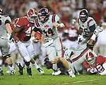 Ole Miss quarterback Bo Wallace (14) vs. Alabama linebacker Xzavier Dickson (47) at Bryant-Denny Stadium in Tuscaloosa, Ala. on Saturday, September 29, 2012. Alabama won 33-14. Ole Miss falls to 3-2.