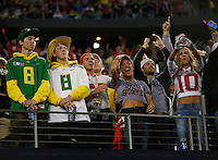 Ohio State Buckeyes fans and Oregon Ducks react in the fourth quarter of the College Football Playoff National Championship between the Ohio State Buckeyes and the Oregon Ducks at AT&T Stadium in Arlington, Texas, Monday afternoon, January 12, 2015. The Ohio State Buckeyes defeated the Oregon Ducks 42 - 20. (The Columbus Dispatch / Eamon Queeney)